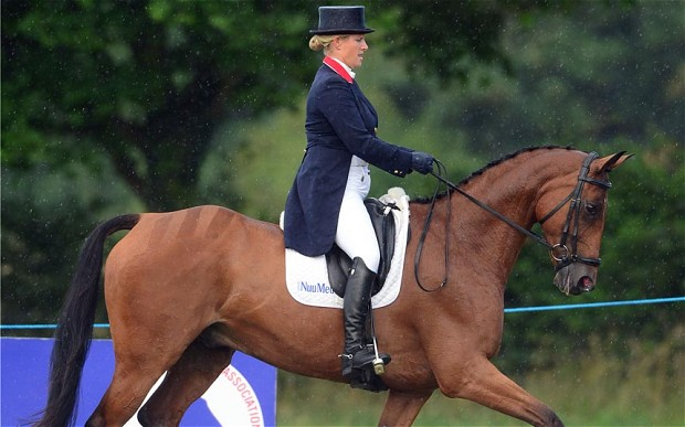 Zara Phillips sports a visible baby bump during on her horse High Kingdom at the Festival of British Eventing. Photo via www.telegraph.co.uk