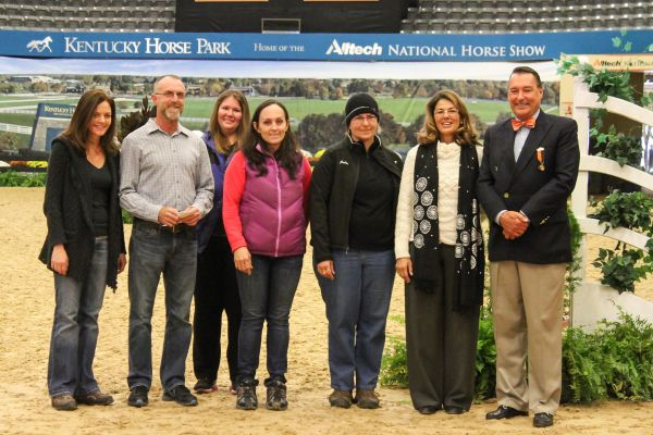 Judge Linda Umla and Alltech National Horse Show President Mason Phelps Jr. present the $2,000 Phelps Media Group Braider's Award to Louise Sinkler, Jeff Claxton and Jennie Vigliano. Photo by Emily Riden.