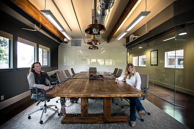 Kim and Carole with Farmyard Darlings custom conference table