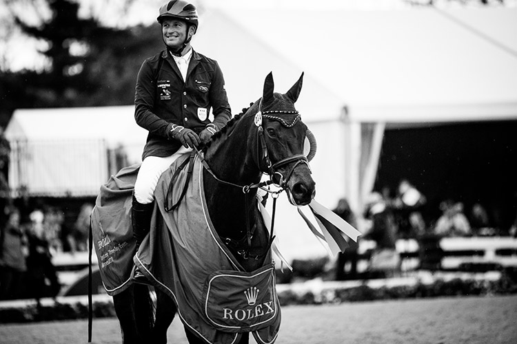 A victory smile – Michael Jung and Fischerrocana | Photo © Ashley Neuhof